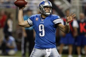 173770-detroit-lions-quarterback-matthew-stafford-looks-for-his-receiver-duri